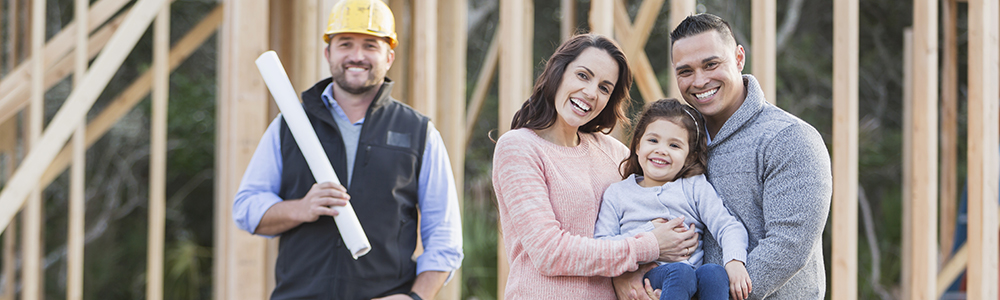 photo of smiling family and construction worker at jobsite